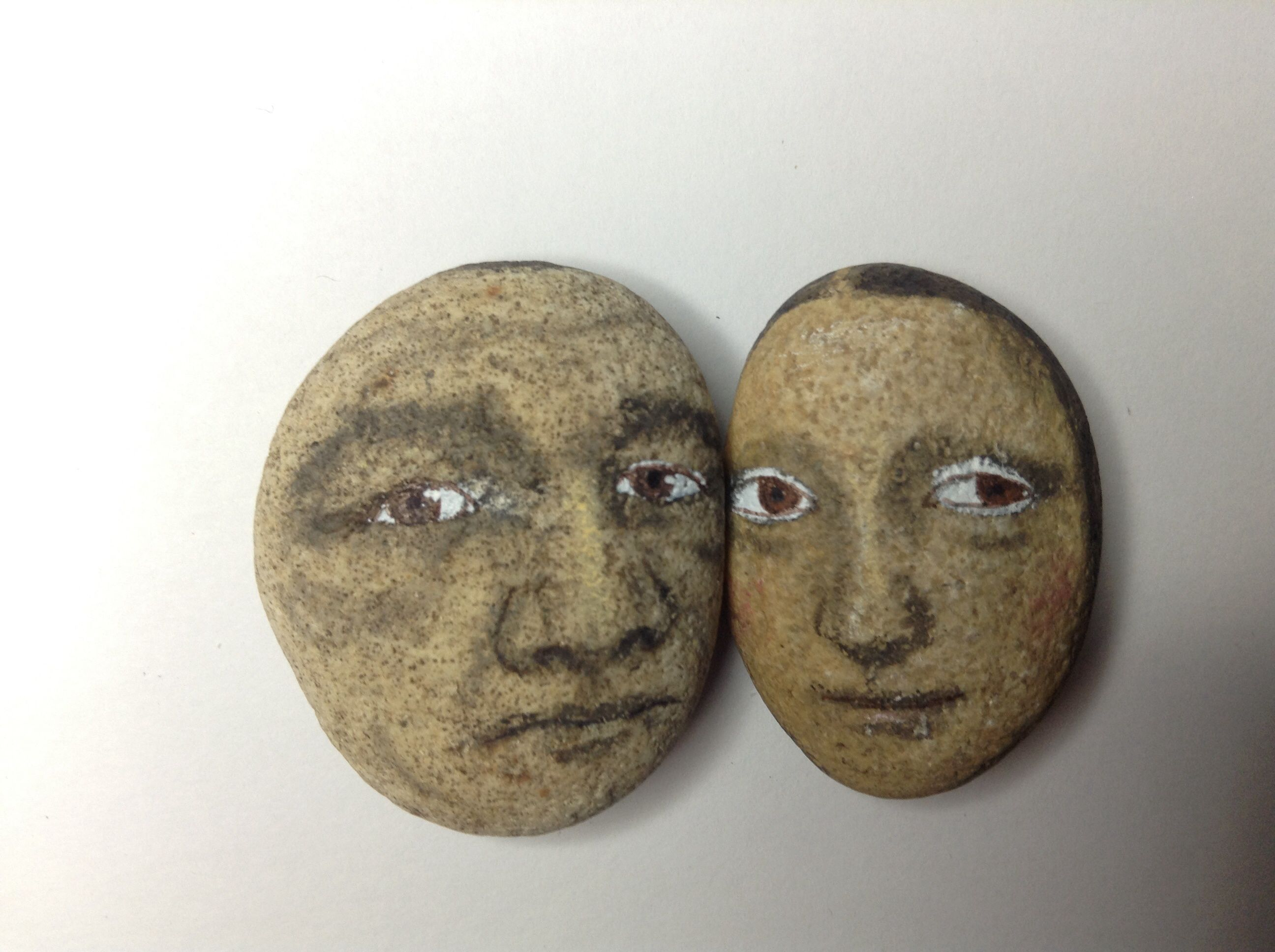 Babe Ruth and Mona Lisa painted river rocks by Artist Kaveman