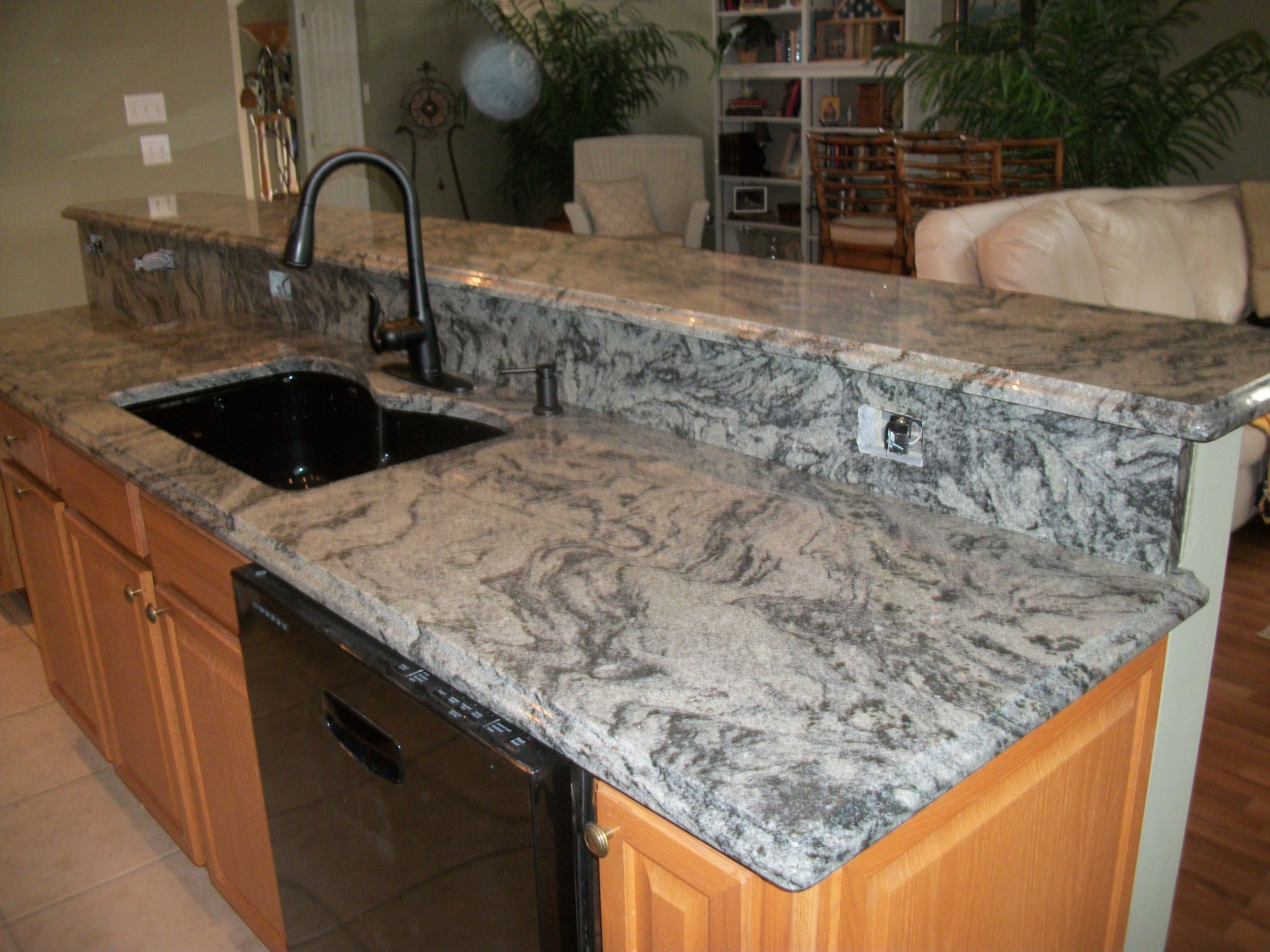 Kitchen counter tops in 3cm candeais granite with ogee edge detail
