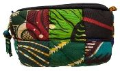 This quilted make-up bag comes from a women's sewing project in Kenya. Various African quilted wax-print fabrics and an African peace symbol are features on this handmade make-up bag.