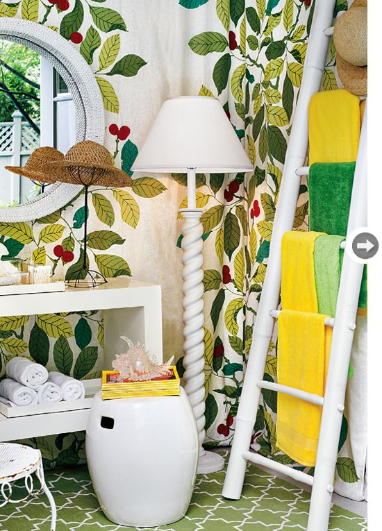 Using a ladder is a unique way to hang towels to dry. It is a great use of vertical space!