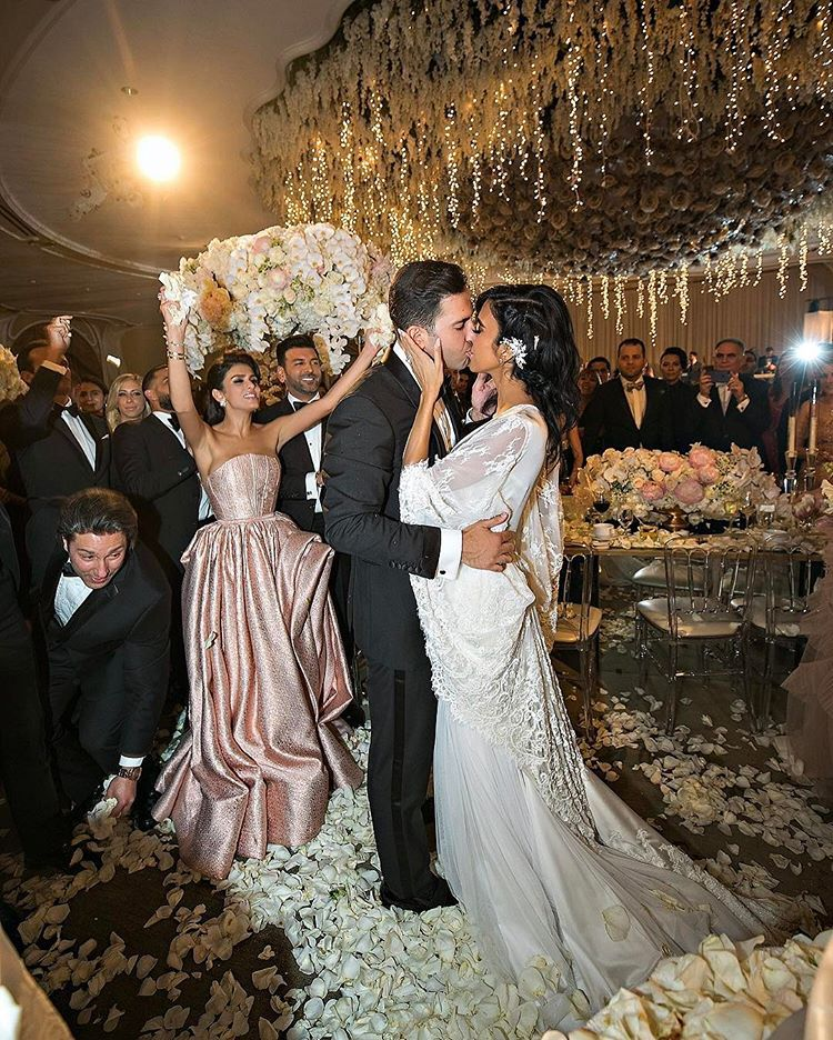 Wardrobe breakdown lilly ghalichi 39 s wedding lace veils for Ryan and walter wedding dress prices
