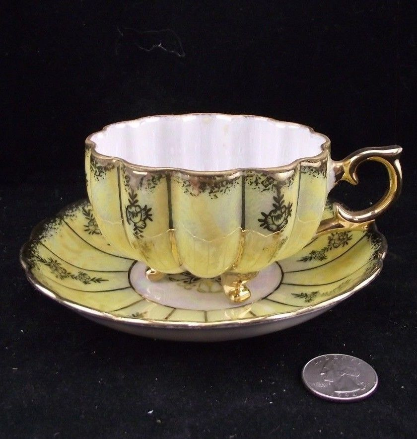 yellow castle china japan 3 footed brushed gold w iridescent tea cup and saucer