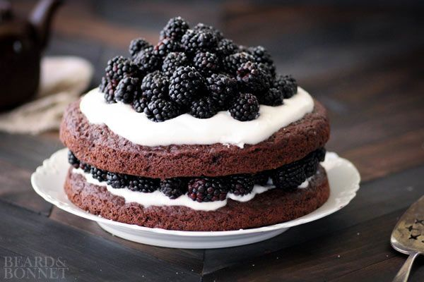 Chocolate cake with blackberries and whipped coconut cream
