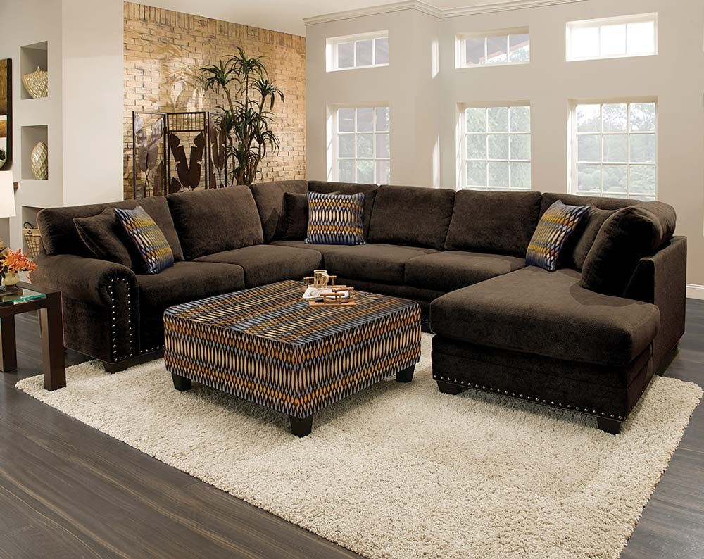 This sectional sofa is gigantic! As in three pieces, gigantic. The U ...