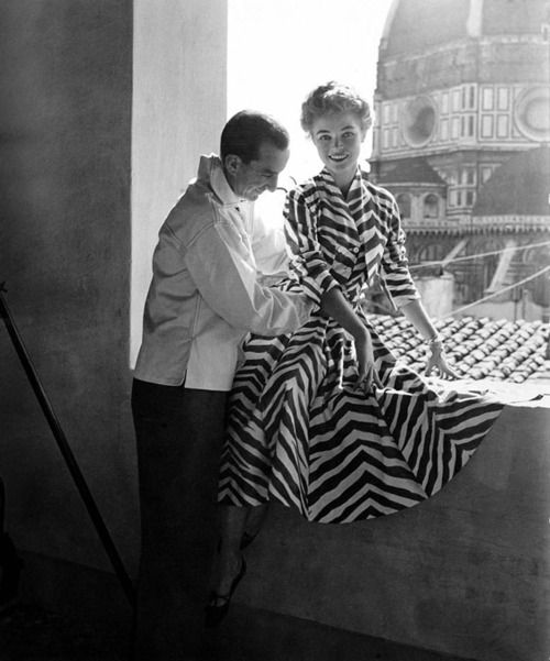Designer Emiliano Pucci prepares a model for a photo shoot in Florence,c. 1950s