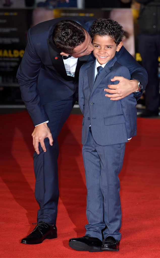 Ronaldo Premiere from Party Pics: London Cristiano Ronaldo gives some lovin' to his son Cristiano Jr. at the Vue West End theater.