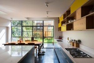 London kitchen remodel by MW Architects with two-story bespoke plywood cabinets | Remodelista