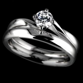 Twisted band engagement ring with matching wedding ring www