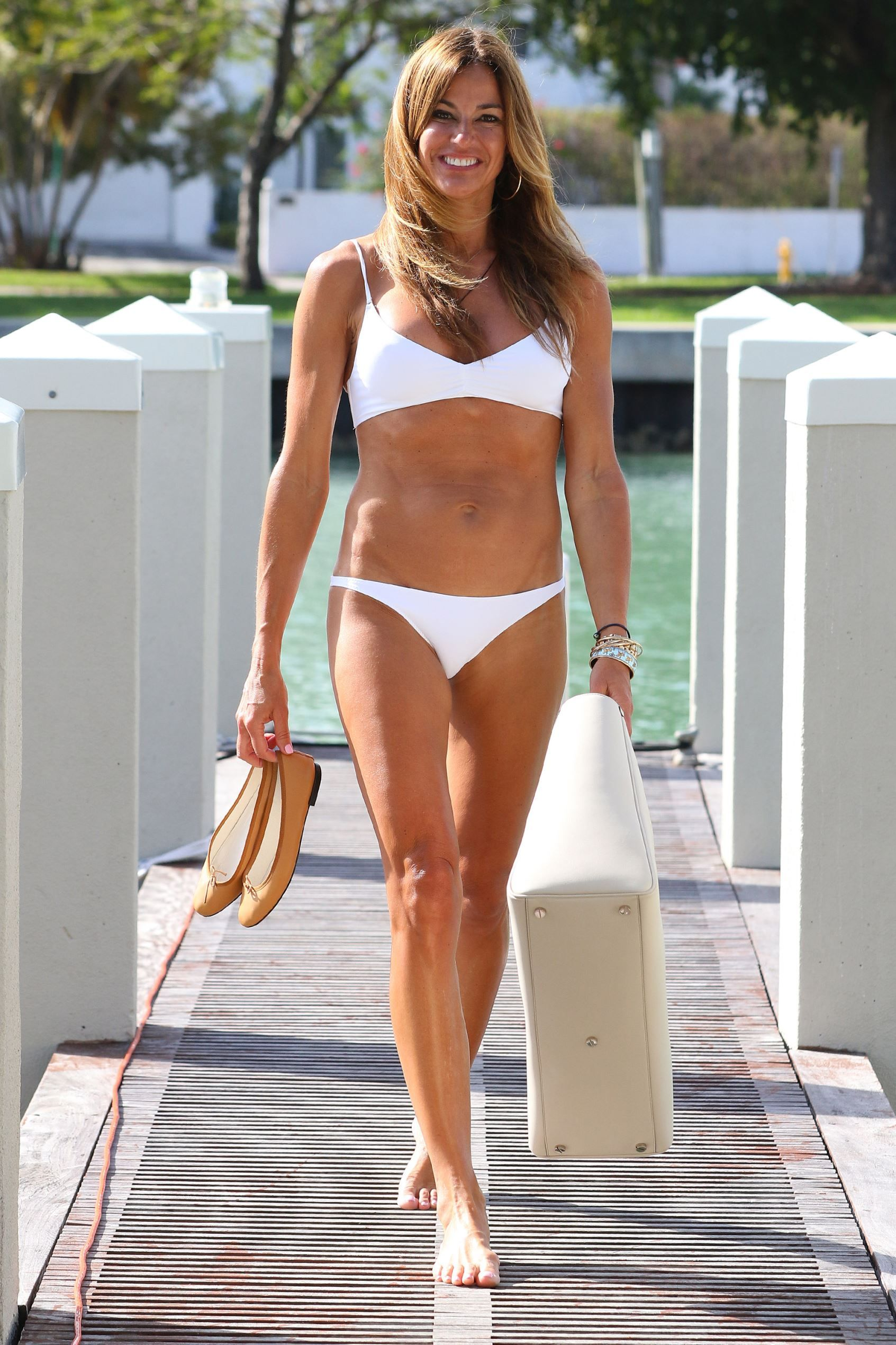 Hottest bikini bodies Celebs over 40  Places to Visit