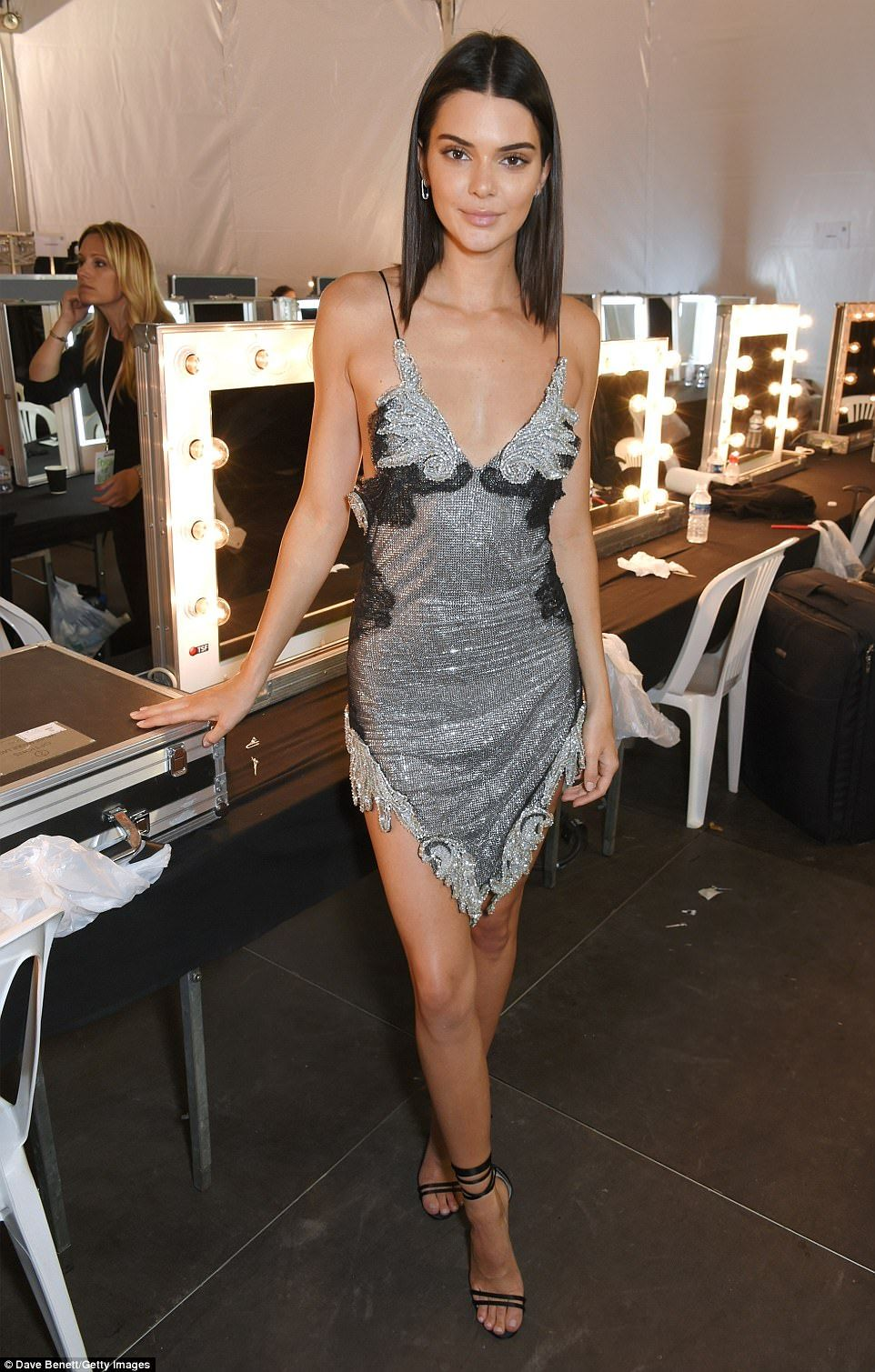 Kendall Was Seen Sporting An Intricate Grey Slip Dress As She Hung Out Backstage At Fashion For Relief
