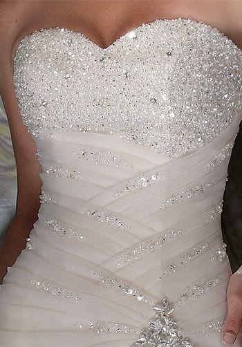 Gorgeous ~ strapless, sweetheart neckline, quite unique wedding dress idea
