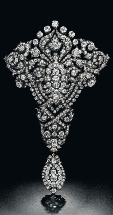 5b3daa04b Maria Christina Royal Devant-de-Corsage brooch (est. $1.5 – 2 million), a magnificent  diamond brooch given as a wedding present by King Alfonso XII of Spain ...