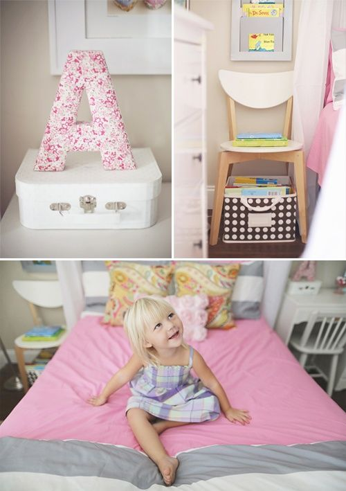 Toddler girl room with fabric letter and wire storage basket.