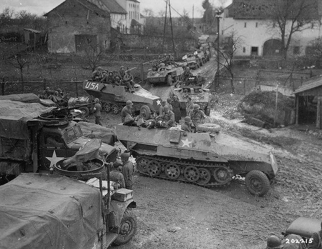 1945, Germany - U.S. infantry using SdKfz 251's.