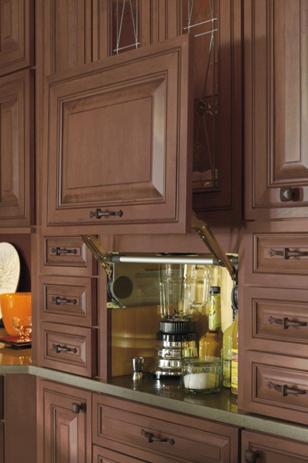 This Appliance Garage Cabinet conceals small appliances, while also ...