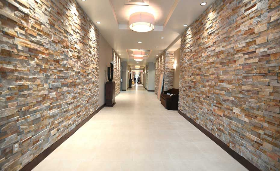 Gold Stacked Stacked Stone Walls In Hallway Of Hotel Stone Walls Interior Stone Wall Interior Design Stone Veneer Wall