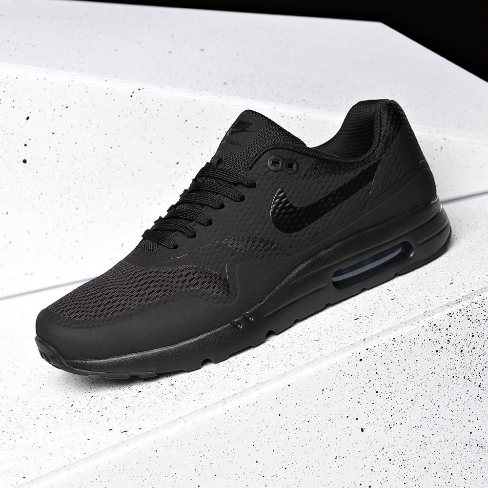 The Nike Air Max 1 Ultra Essential Trainer in all black.