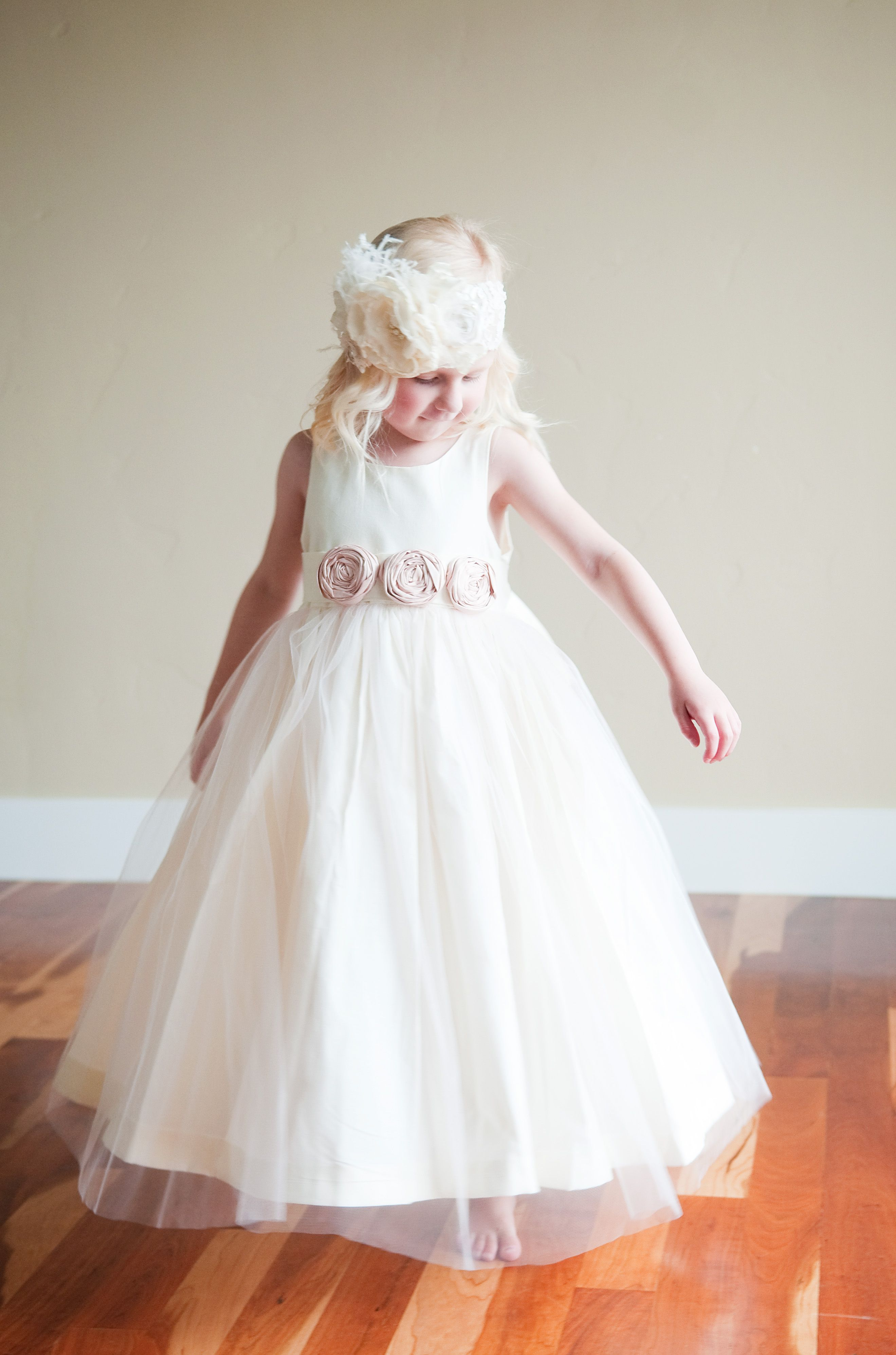 A Cotton And Tulle Flower Girl Dress With Blush Pink Silk Rosettes