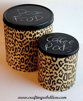 Popcorn tins upcycled into storage containers. Chalkboard paint on the top so you can re-label. ~~ this is what I can do with the leopard print and zebra print duct tape I just bought.