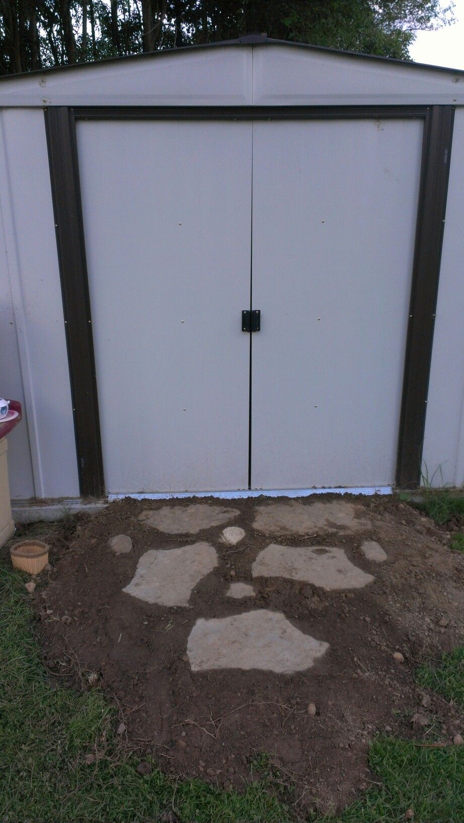 dirt and stone ramp into the shed beautified backyard