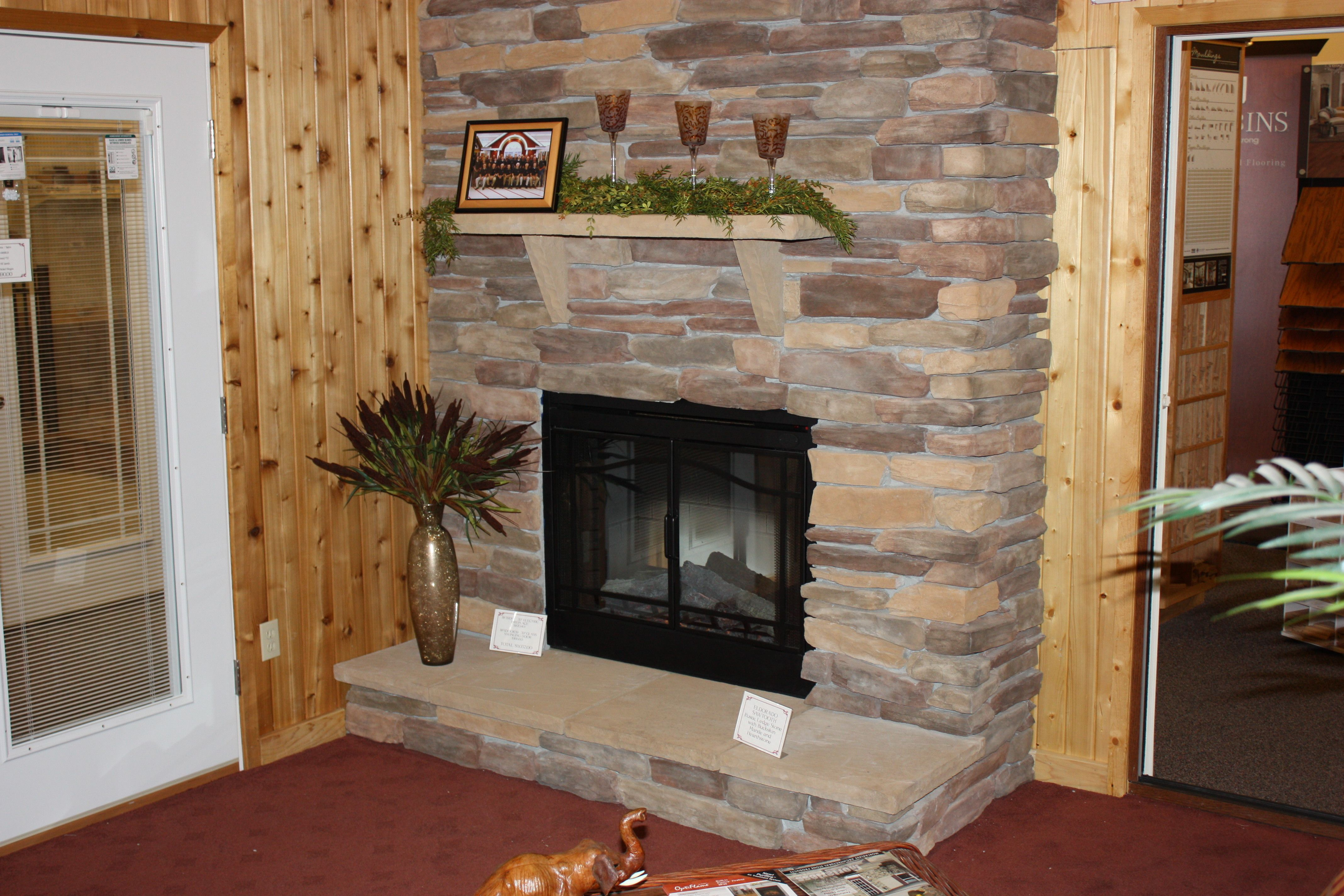Eldorado stacked stone with mortar, mantle and raised fireplace base.