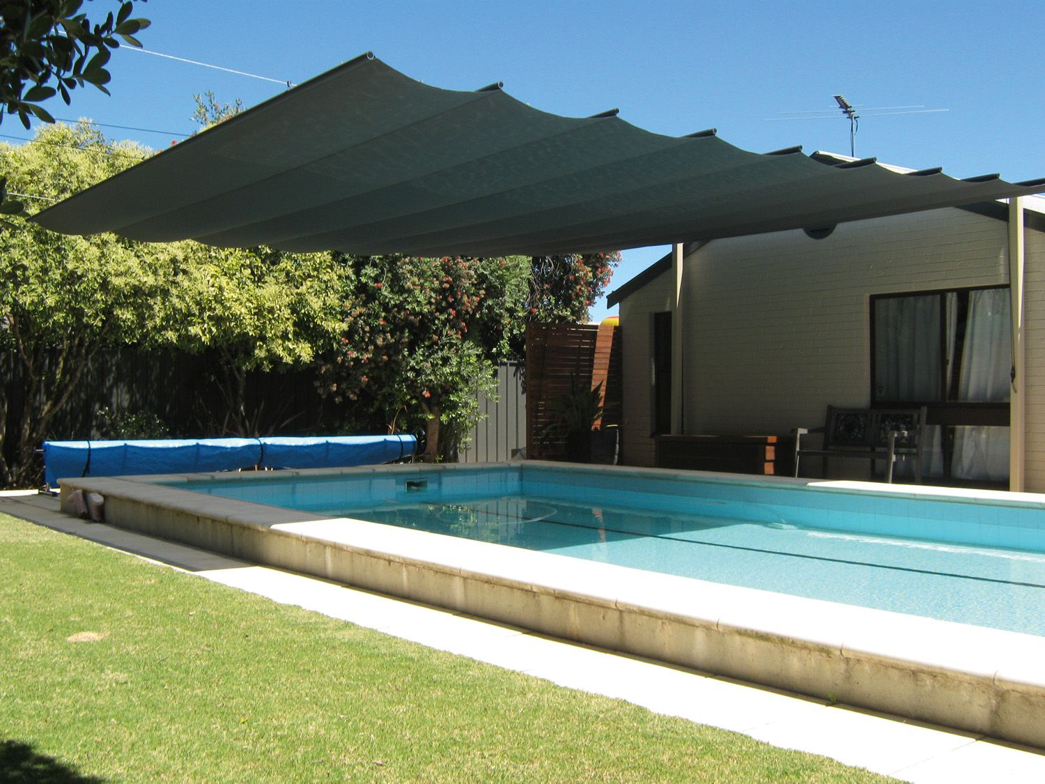 Cool Your Outdoor Entertaining Area With A Retractable Shade System Pool Shade Backyard Shade Outdoor Shade
