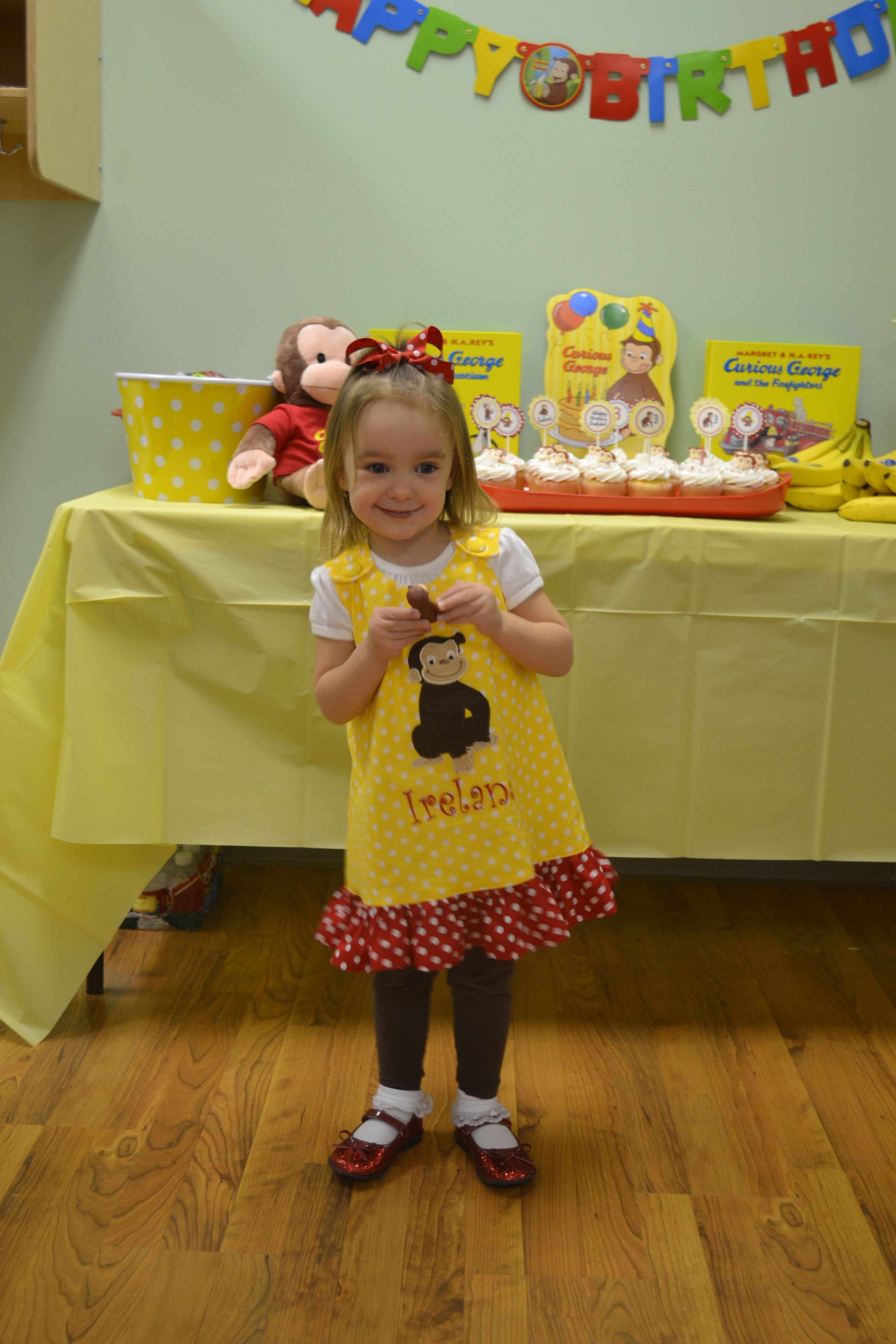 The Birthday Girl Wearing A Darling Curious George Dress