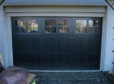 Custom Carriage Garage Doors For Your Beautiful Home Built And Installed To Roll Up In Sections As Carriage House Doors Custom Wood Garage Doors Garage Doors