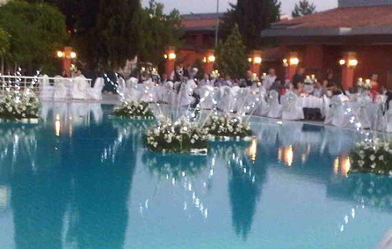 Floating Flowers for Outdoor Pool Weddings   Pool wedding ...