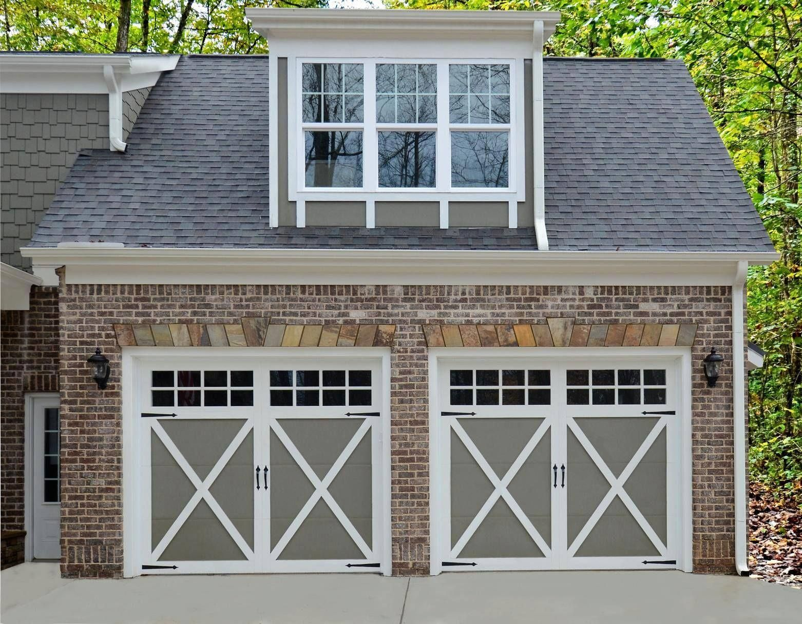 Yes You Can Paint Your Garage Door To Match Your Exterior Paint Color Scheme We Love The Sage Green Against This Red Brick Doors Shown Cl Garage Door Design Exterior Paint