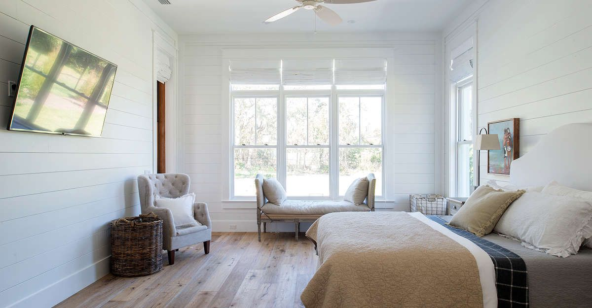 Bedroom With Painted Wood Paneling Using Shiplap Wall