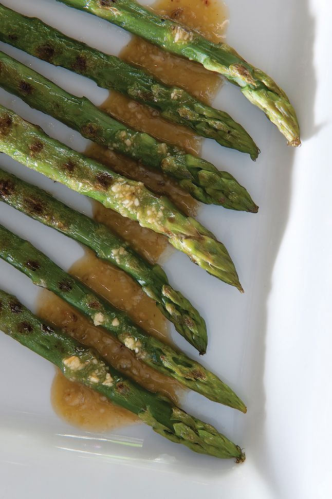 Griddled asparagus with Parmesan and pine nut dressing