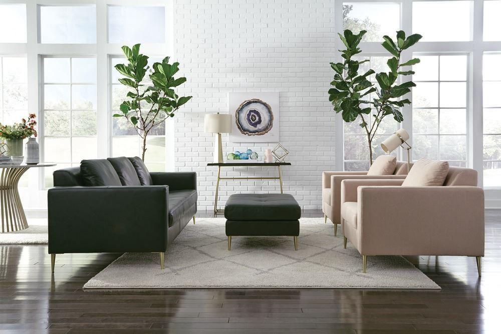 Sofa fixe avec assise en cuir vert avec les pattes de couleur or et