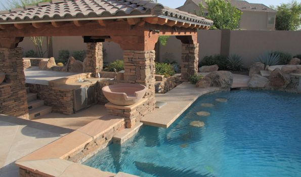 swimming pool perfect combination swimming pool and swim up bar design inspiration with natural stone - Swim Pool Designs