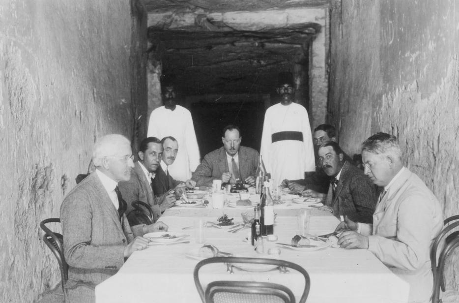 Egyptologist Howard Carter hosting a meal in the tomb the pharaoh Tutankhamun.