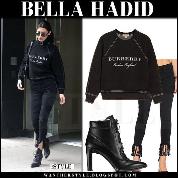 Bella Hadid in black sweatshirt, black fringes jeans and black ankle boots