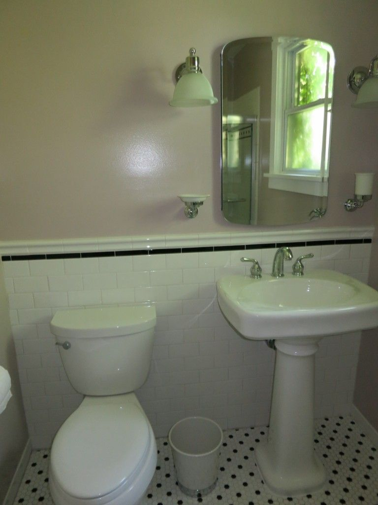 subway tile and hex floor bathroom with taupe walls