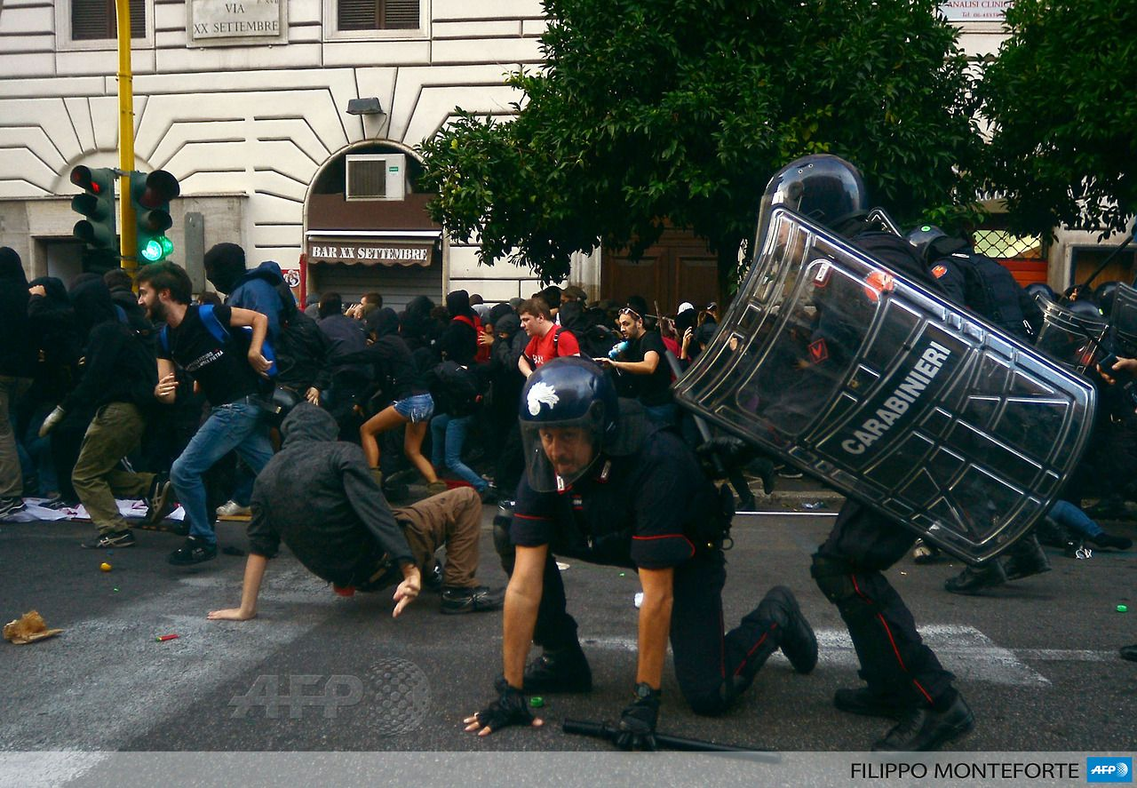 ITALY, Rome : People clash with police near the Economy ...