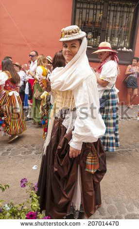 "LA OROTAVA, SPAIN - JUNE 29: Dancers and singers of the festival ""A Pilgrimage to San Isidro Labrador / La romer­a de San Isidro Labrador"" on June 29, 2014 in Tenerife (Canary Islands) Spain. - stock photo"