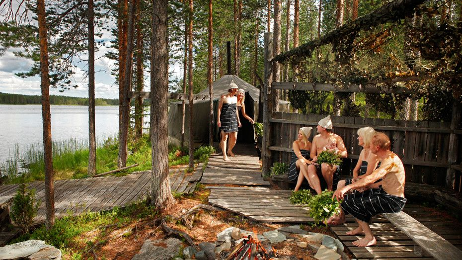 Cooling off and relaxing by the lake after a sauna. (Photo
