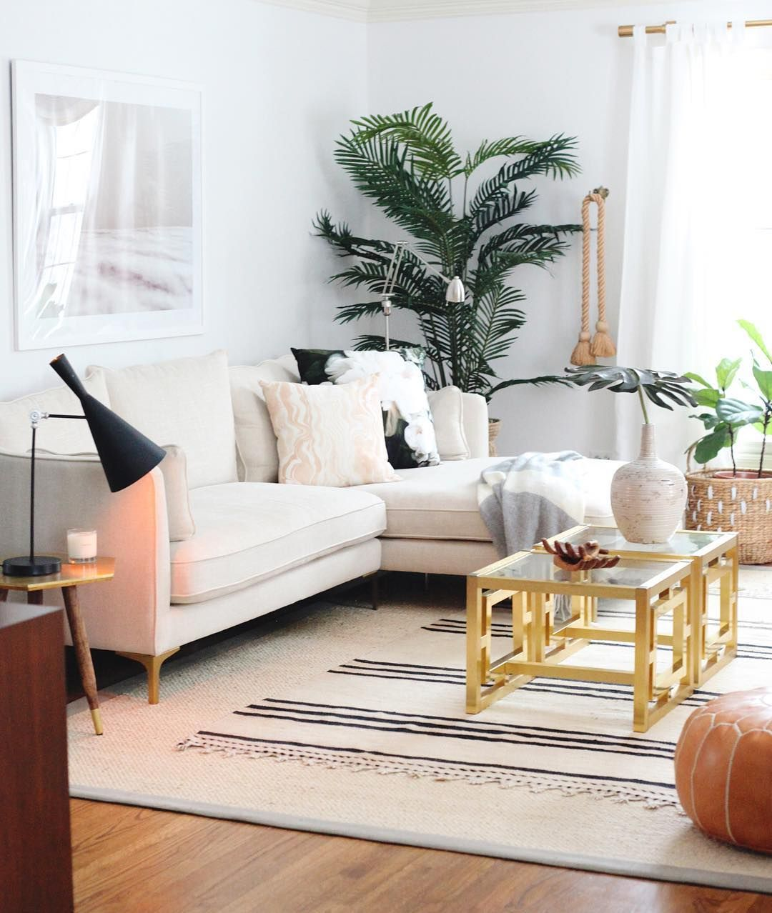 White Sofa And Layered Rugs For A Modern Eclectic Home Decor Style With Touch Of Boho