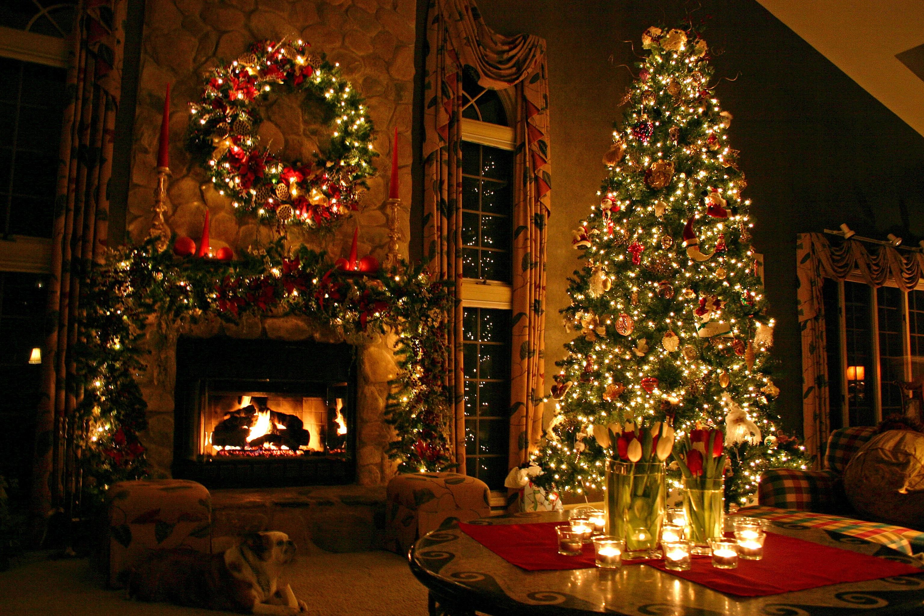 A Cozy Scene With A Beautiful Christmas Tree Wreath Fireplace