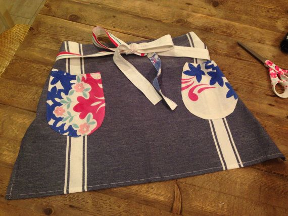 French Country half apron. Denim blue cotton fabric and antique vintage fabric. Very cute for you and in your kitchen. Handmade by Christina 15 1/2 long One size fits all