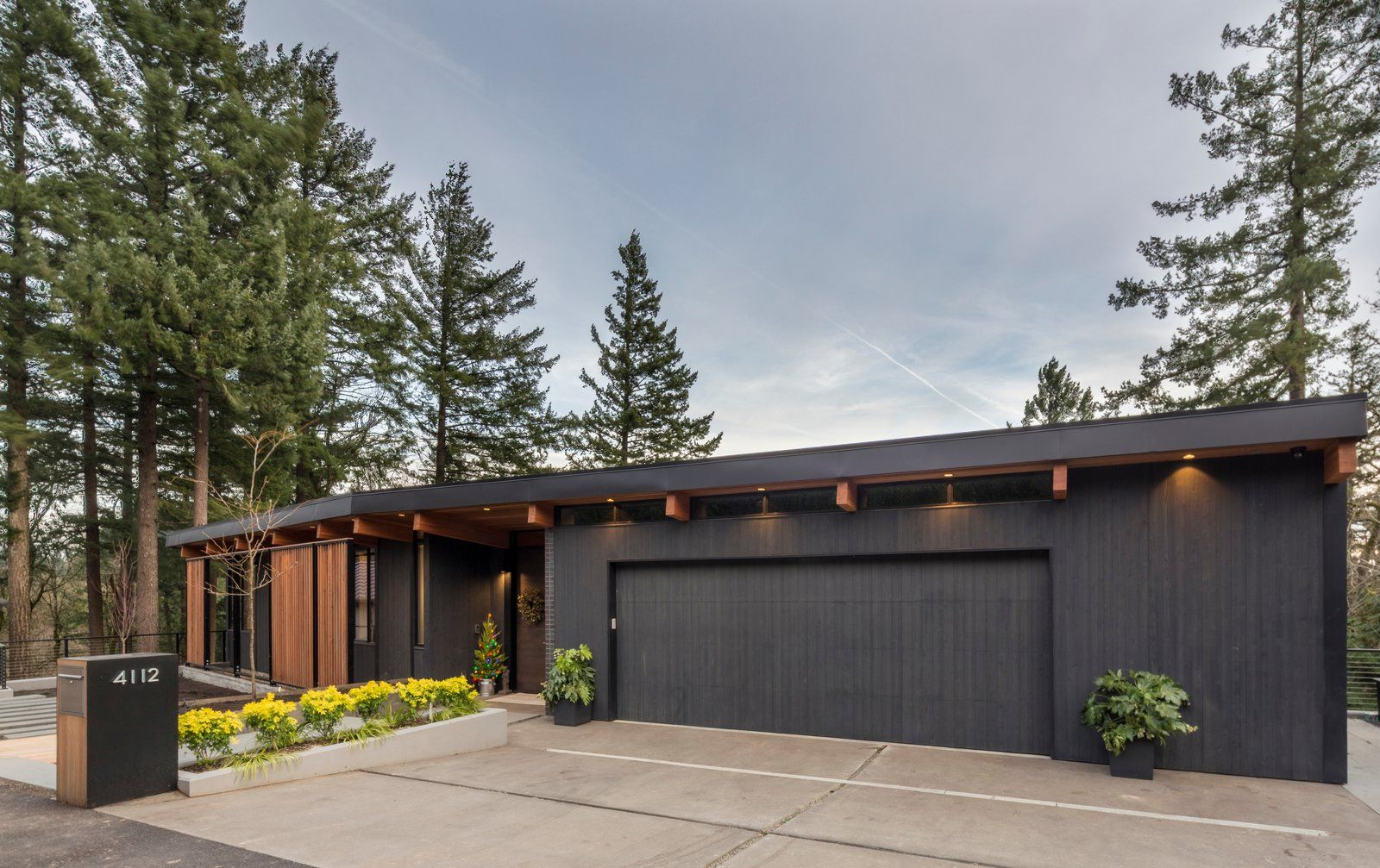 Exterior Brick Siding Material House Building Type Butterfly Roofline And Wood Siding Mat Gray House Exterior Midcentury Modern Mid Century Modern Exterior