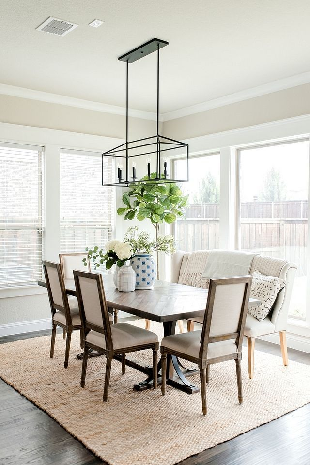 Farmhouse Dining Room With Black Lantern Chandelier And Upholstered Dining Chairs And Dining Bench Neutral Dining Room Modern Dining Room Farmhouse Dining Room