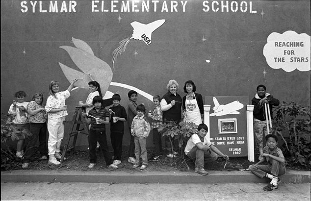 This memorial, dedicated to the crew of the Space Shuttle Challenger, was designed by Dr. Yvonne Chan, principal at Sylmar Elementary in 1987. All grades worked on the project. Pictured (l-r): Kerrie Kaulbach, Jennifer Furman, Stacy Chambers, Marcel Jimenez, Armand Villavert, Manuel Munoz, Rosalie Monreal, Victor Montes, Jasnon Voss, Mary Hamerson, Dr. Chan, Jorge Ocampo, Eric Thompson, and Dione Brown. Robert and Betty Franklin Collection. San Fernando Valley History Digital Library.