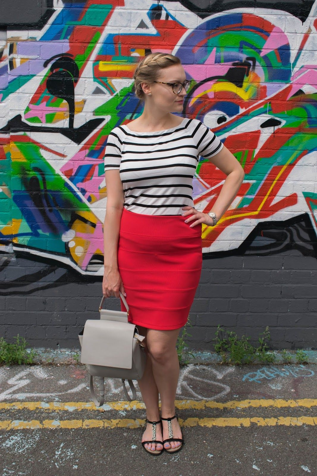 3cfc92080585c5 Colourful blogger style with Wardrobe Conversations. Breton stripe bardot  top and bold red pencil skirt with grey backpack.