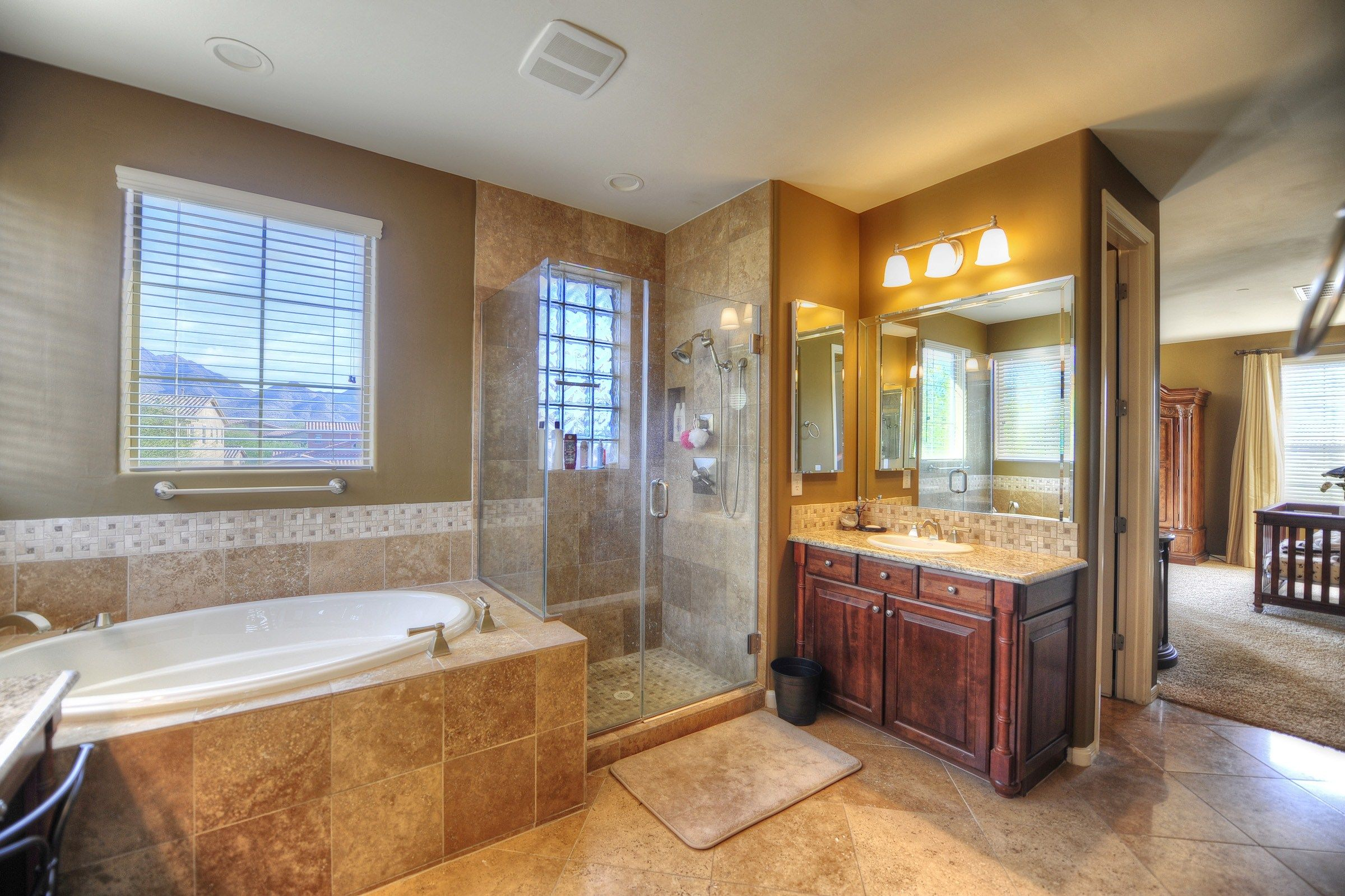 Lavish Master Bathroom With Soaking Tub Shower And Travertine