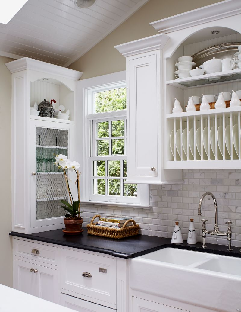 Great idea for the narrow space. Love the cabinets, sink and counter ...