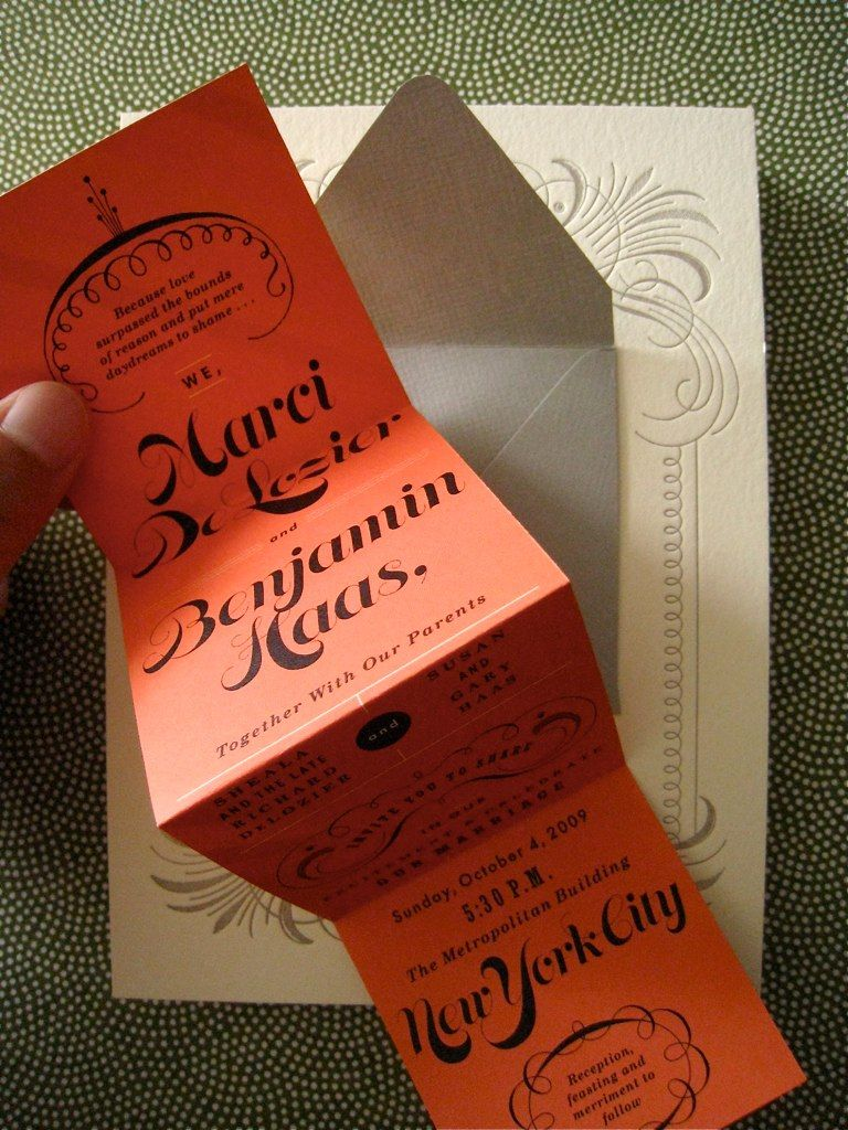 mini accordion-folded strip of paper with main invitation wording ...